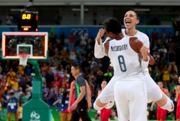 RIO DE JANEIRO, BRAZIL - AUGUST 20:  Angel Mccoughtry #8 and Diana Taurasi #12 of United States celebrate after winning the Women's Gold Medal Game between United States and Spain on Day 15 of the Rio 2016 Olympic Games at Carioca Arena 1 on August 20, 2016 in Rio de Janeiro, Brazil.  (Photo by Tom Pennington/Getty Images)