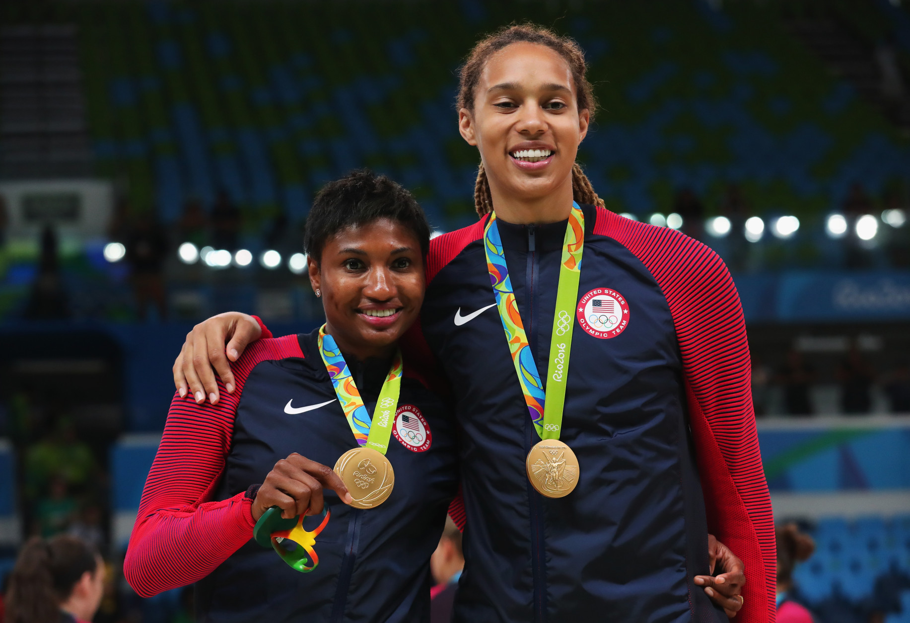 RIO DE JANEIRO, BRAZIL - AUGUST 20:  (L-R) Gold medalists Angel Mccoughtry #8 and Brittney Griner #15 of United States celebrate during the medal ceremony after the Women's Basketball competition on Day 15 of the Rio 2016 Olympic Games at Carioca Arena 1 on August 20, 2016 in Rio de Janeiro, Brazil.  (Photo by Tom Pennington/Getty Images)