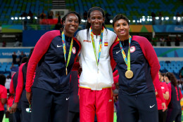 RIO DE JANEIRO, BRAZIL - AUGUST 20:  (L-R) Gold medalist Tina Charles #14 of United States, Silver medalist Astou Ndour Gueye #45 of Spain, and gold medalist Angel Mccoughtry #8 of United States celebrate after the Women's Basketball competition on Day 15 of the Rio 2016 Olympic Games at Carioca Arena 1 on August 20, 2016 in Rio de Janeiro, Brazil.  (Photo by Tom Pennington/Getty Images)
