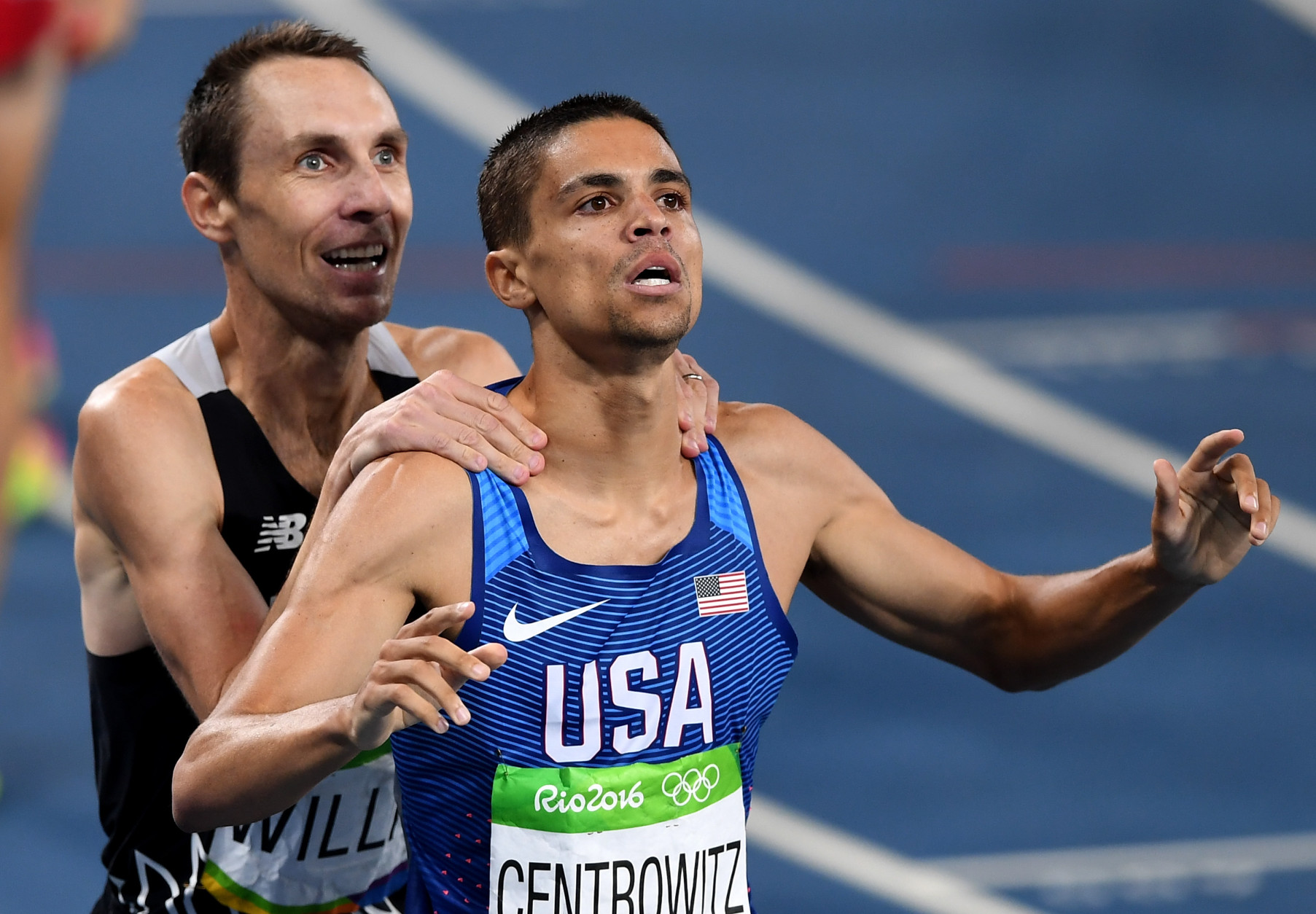 RIO DE JANEIRO, BRAZIL - AUGUST 20:  Matthew Centrowitz of the United States reacts with Nicholas Willis of New Zealand after winning gold and bronze respectively in the Men's 1500 meter Final on Day 15 of the Rio 2016 Olympic Games at the Olympic Stadium on August 20, 2016 in Rio de Janeiro, Brazil.  (Photo by Shaun Botterill/Getty Images)