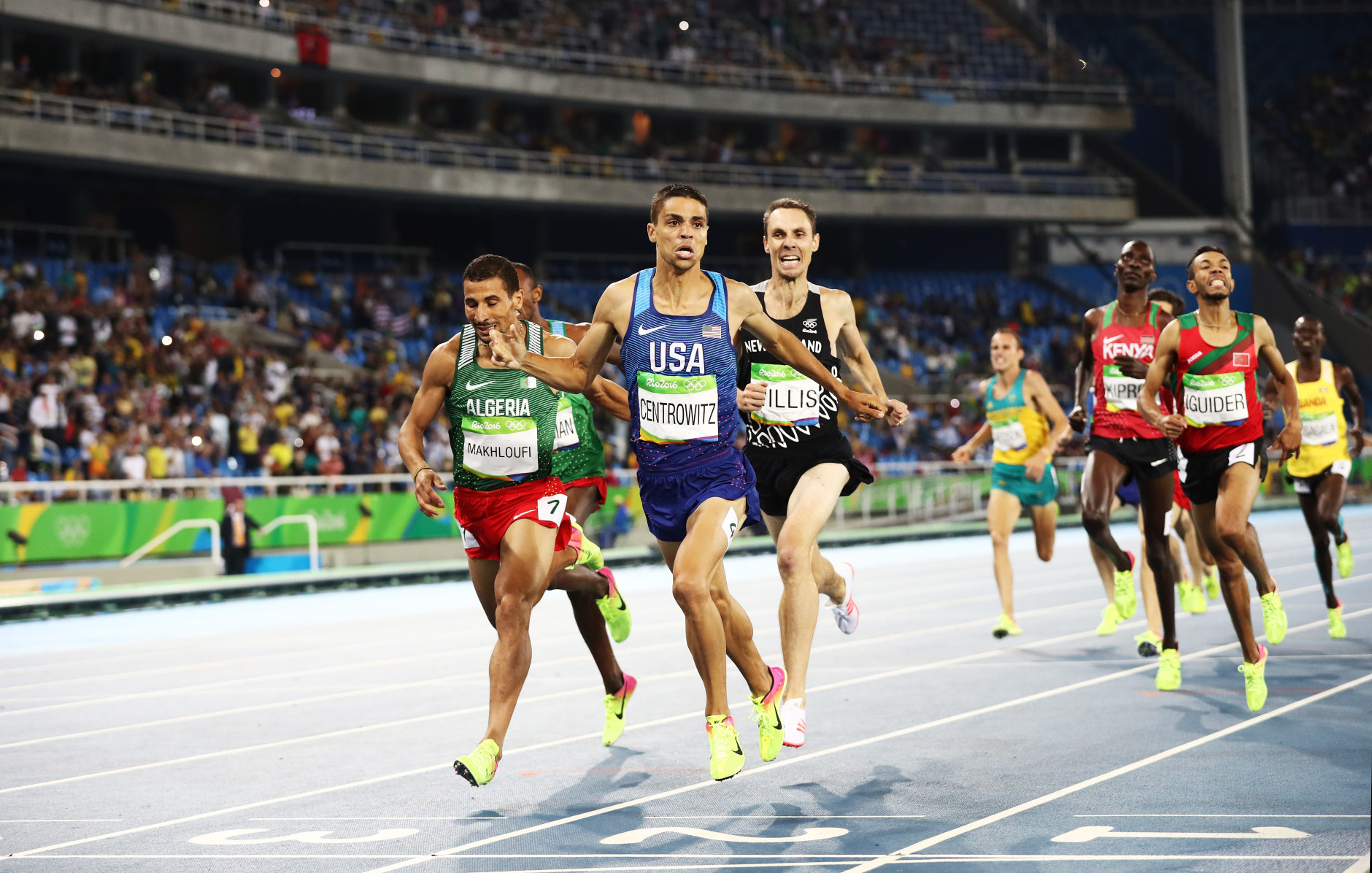 RIO DE JANEIRO, BRAZIL - AUGUST 20:  Matthew Centrowitz of the United States reacts after winning gold in front of Taoufik Makhloufi of Algeria and Nicholas Willis of New Zealand in the Men's 1500 meter Final on Day 15 of the Rio 2016 Olympic Games at the Olympic Stadium on August 20, 2016 in Rio de Janeiro, Brazil.  (Photo by Ezra Shaw/Getty Images)