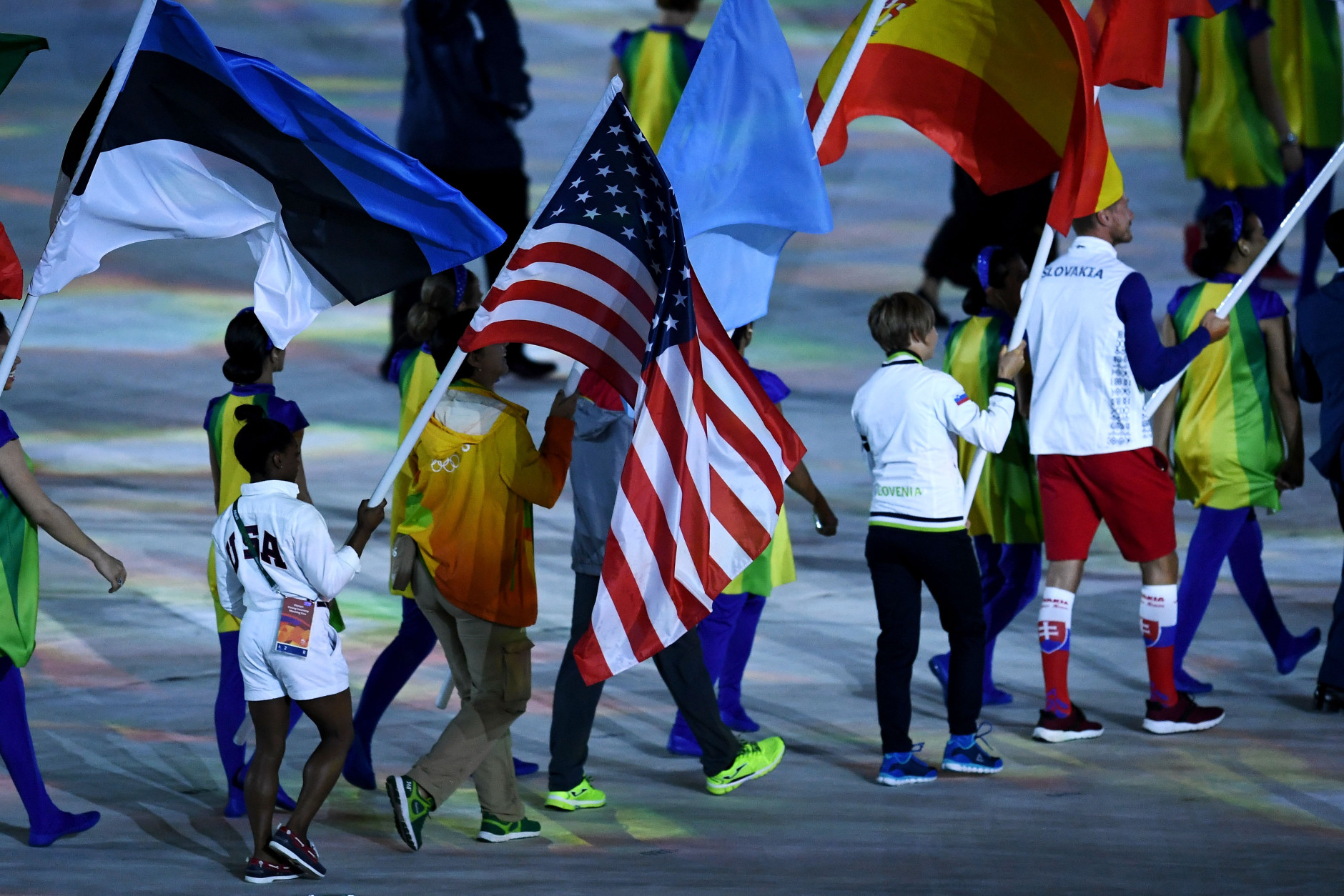"""RIO DE JANEIRO, BRAZIL - AUGUST 21: Flag bearer Simone Biles of United States walks during the """"Heroes of the Games"""" segment during the Closing Ceremony on Day 16 of the Rio 2016 Olympic Games at Maracana Stadium on August 21, 2016 in Rio de Janeiro, Brazil.  (Photo by David Ramos/Getty Images)"""