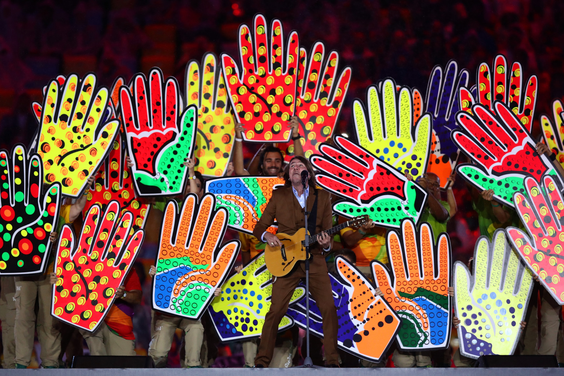 RIO DE JANEIRO, BRAZIL - AUGUST 21:  Singer Lenine performs during the Recognition of the Volunteers segment during the Closing Ceremony on Day 16 of the Rio 2016 Olympic Games at Maracana Stadium on August 21, 2016 in Rio de Janeiro, Brazil.  (Photo by Ezra Shaw/Getty Images)