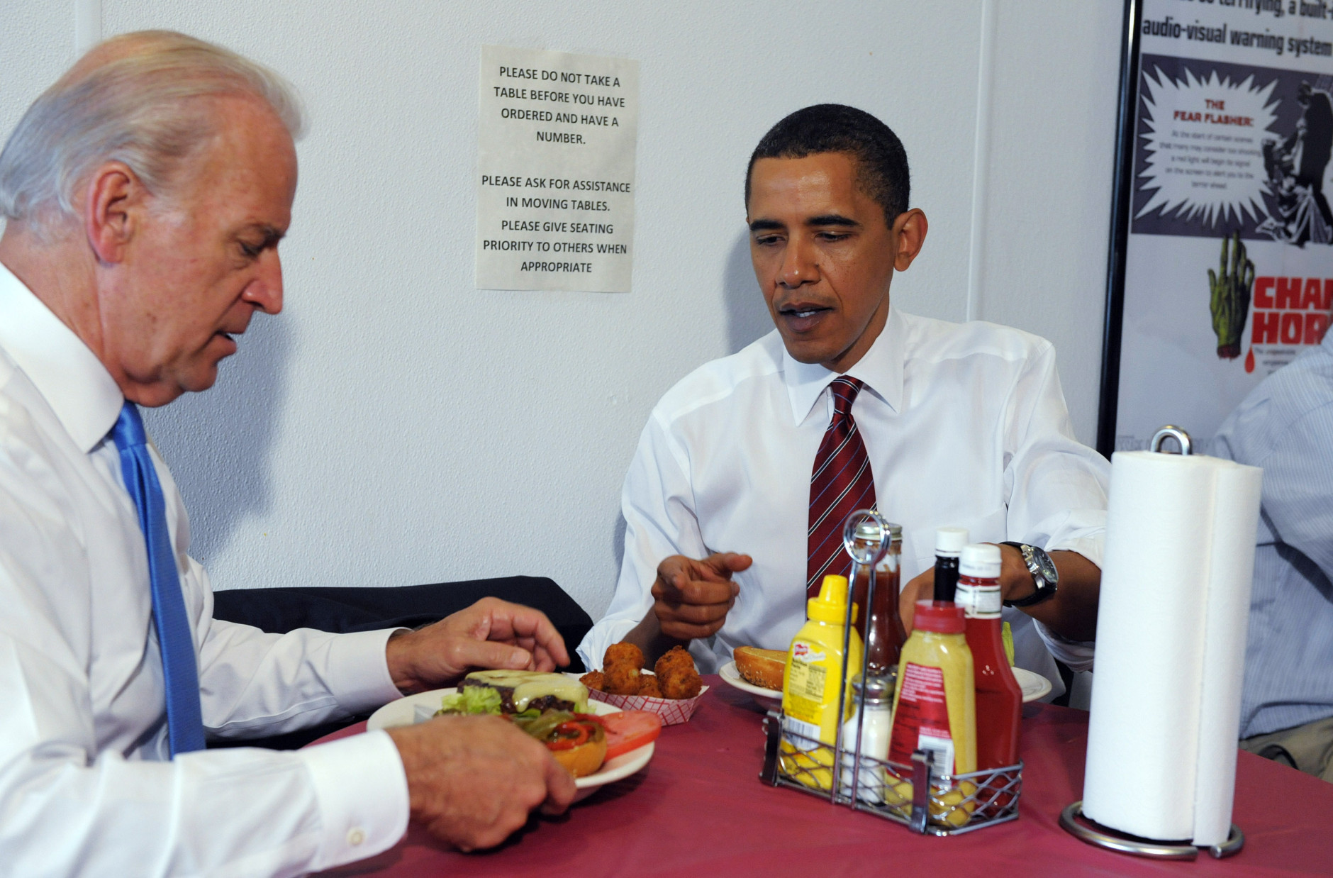 ARLINGTON, VA - MAY 5:  U.S. President Barack Obama (R) and U.S. Vice President Joe Biden sit at a table with their cheeseburger lunch orders at Ray's Hell Burger May 5, 2009 in Arlington, Virginia. Obama and Biden made an unannouced vist to the Arlington restaurant.   (Photo by Roger L. Wollenberg-Pool/ Getty Images)