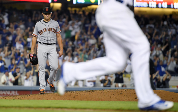 Giants' Moore loses no-hitter with two outs in ninth