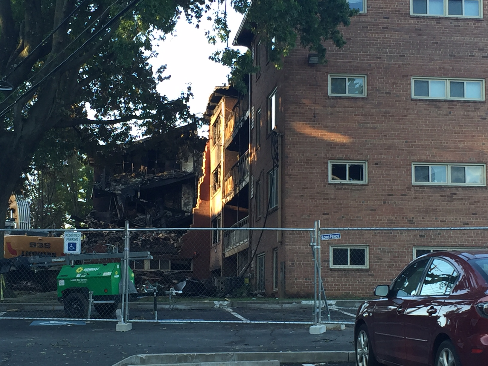 A third body was found on Friday, Aug. 12 in the rubble caused by a fire and explosion in a Silver Spring apartment complex. (WTOP/Dennis Foley)