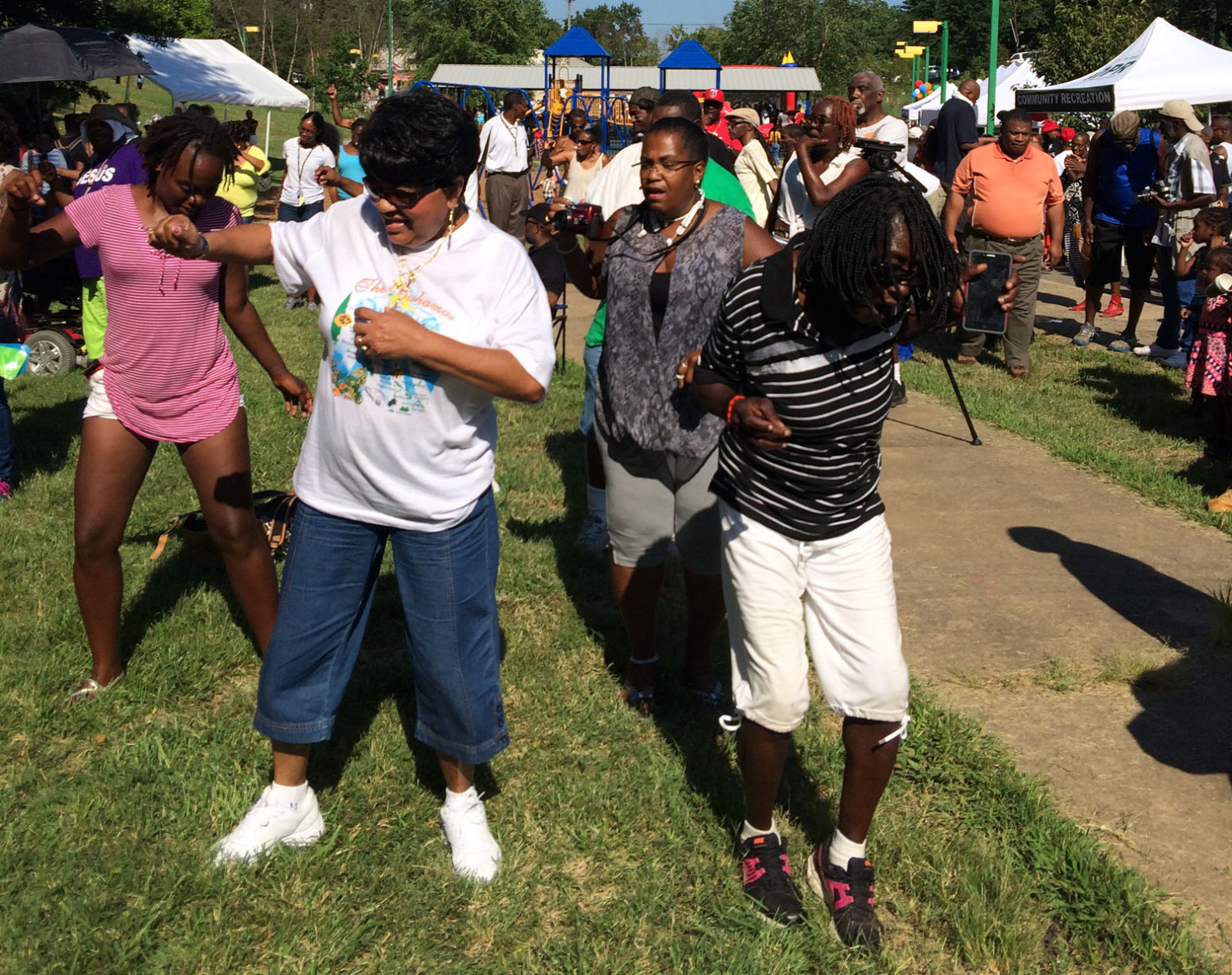 Hundreds of people moved and grooved to the music of the Chuck Brown Band, Plunky and the Oneness, and Secret Society on stage at Chuck Brown Memorial Park (2901 20th St. NE). (WTOP/Dick Uliano)
