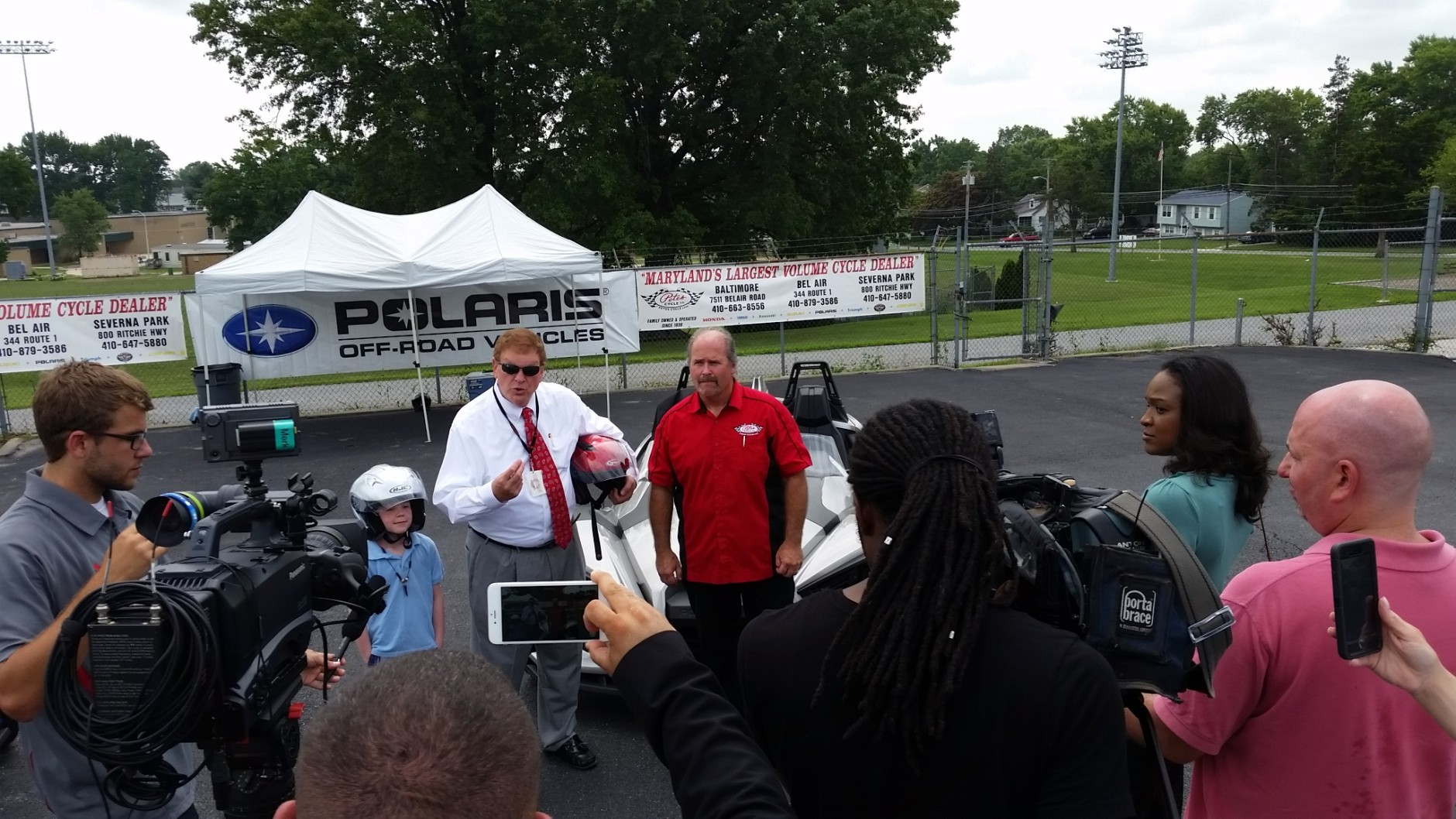 """Maryland Transportation Secretary Pete Rahn, center, pictured with his grandson and Pete's Cycles Vice-President John Leach. """"I was shocked by the growl that the thing had when I started it up,"""" Rahn told WTOP. (Courtesy Maryland Department of Transportation)"""
