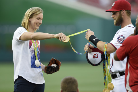 Ledecky hands medals to Harper, throws out first pitch
