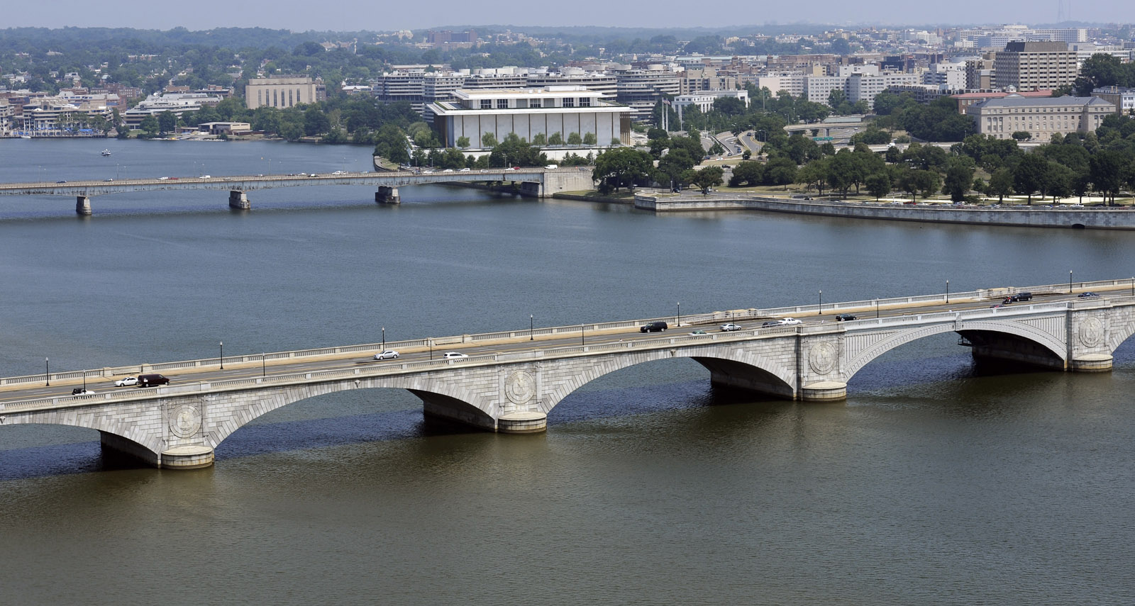 An aerial view of the Kennedy Center for the Performing Arts, center back,  Key Bridge, center, and Memorial Bridge, forground, and the Potomac River in Washington, Friday, July 29, 2011. (AP Photo/Cliff Owen)