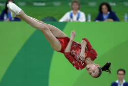 China's Shang Chunsong performs on the floor during the artistic gymnastics women's qualification at the 2016 Summer Olympics in Rio de Janeiro, Brazil, Sunday, Aug. 7, 2016. (AP Photo/Rebecca Blackwell)