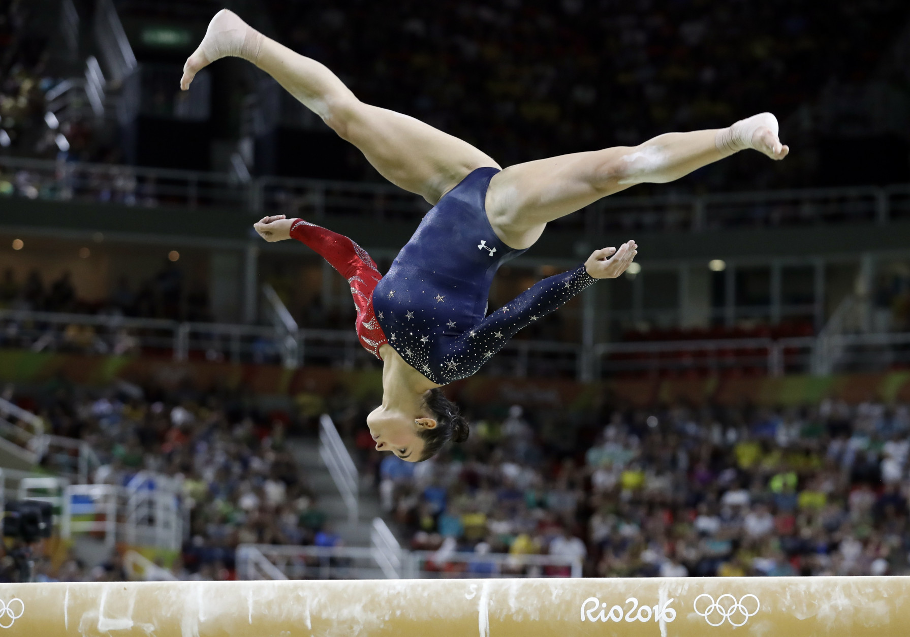 United States' Aly Raisman performs on the balance beam during the artistic gymnastics women's qualification at the 2016 Summer Olympics in Rio de Janeiro, Brazil, Sunday, Aug. 7, 2016. (AP Photo/Rebecca Blackwell)