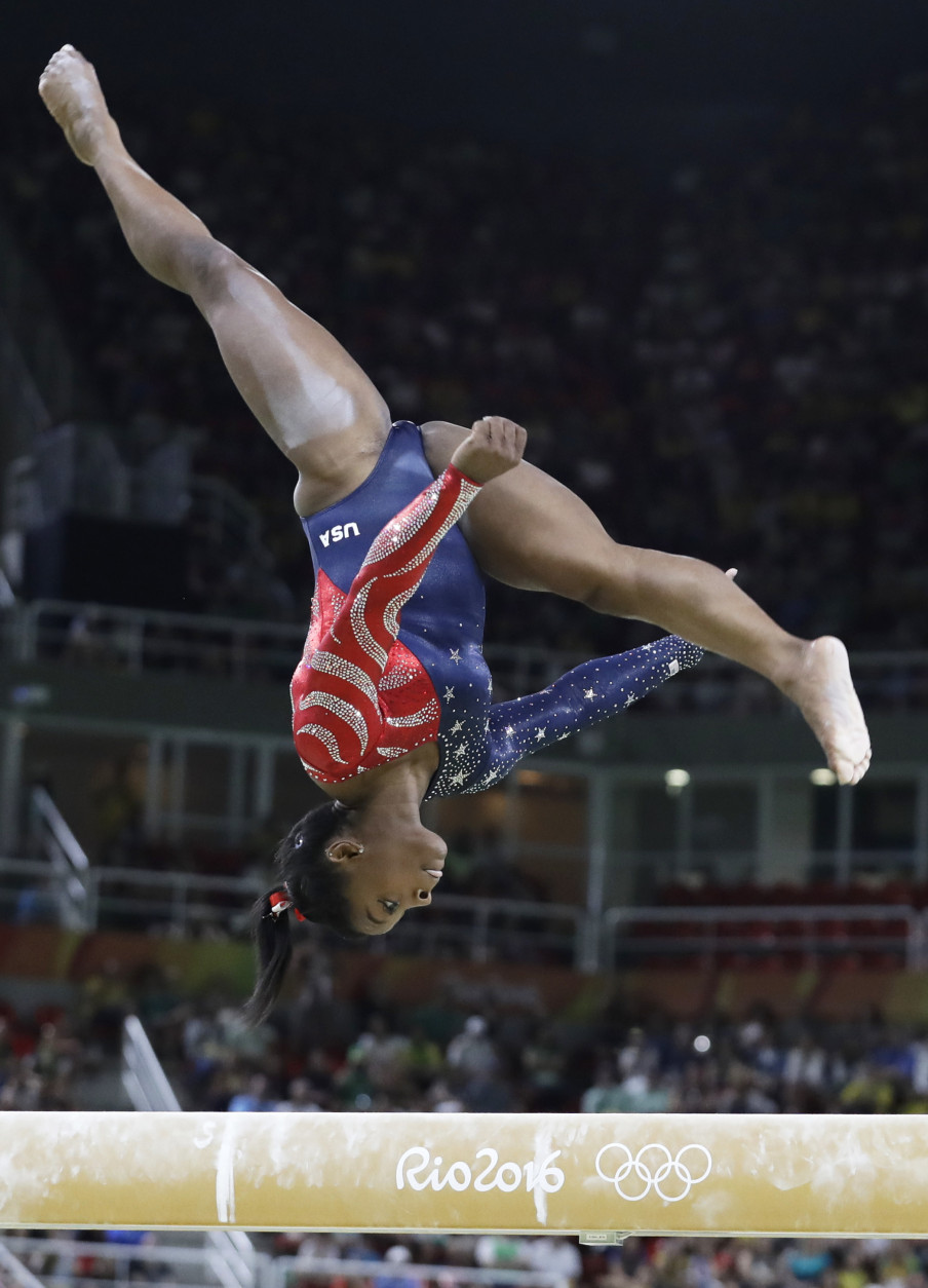 United States' Simone Biles performs on the balance beam during the artistic gymnastics women's qualification at the 2016 Summer Olympics in Rio de Janeiro, Brazil, Sunday, Aug. 7, 2016. (AP Photo/Rebecca Blackwell)