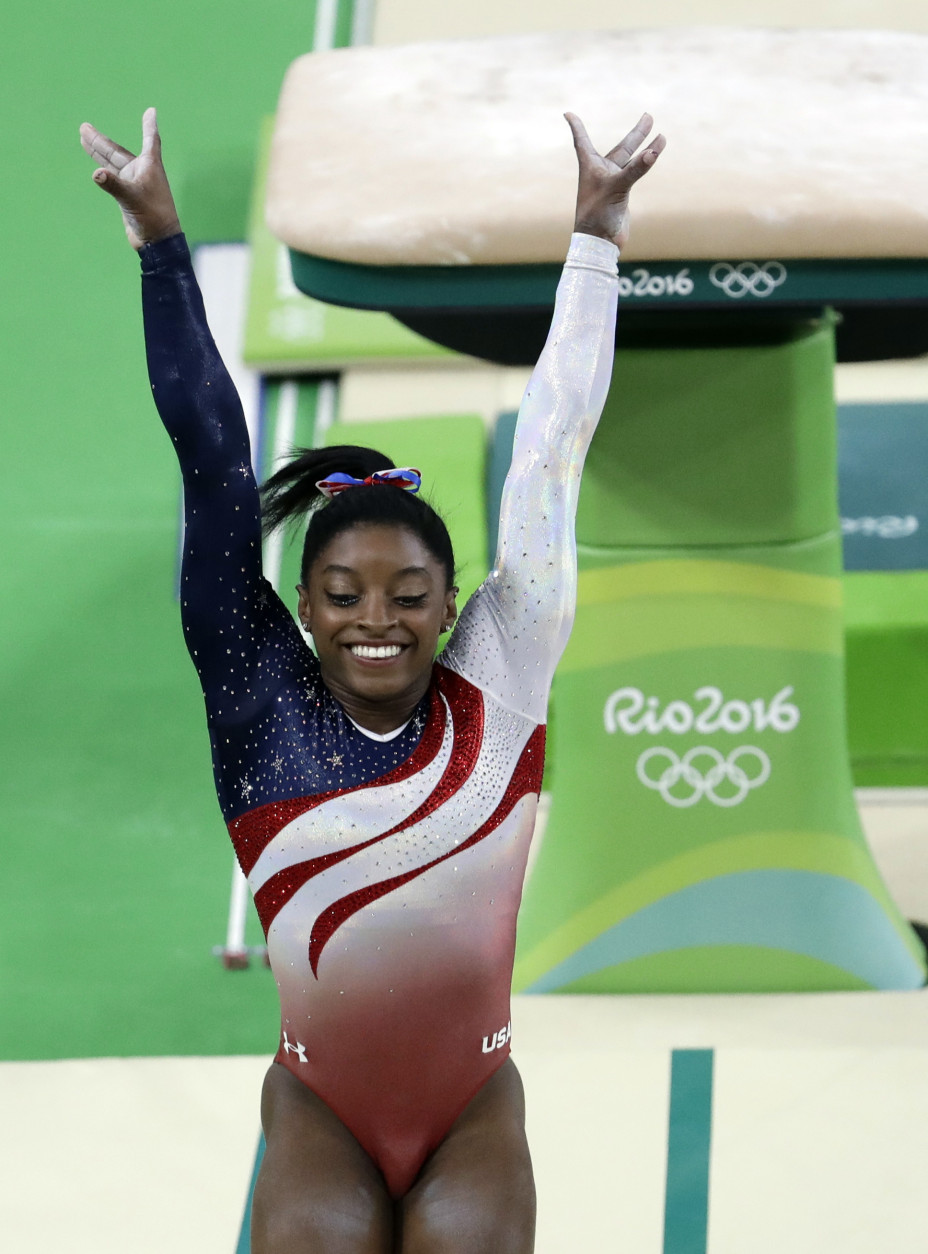 United States' Simone Biles completes her routine on the vault during the artistic gymnastics women's team final at the 2016 Summer Olympics in Rio de Janeiro, Brazil, Tuesday, Aug. 9, 2016. (AP Photo/Dmitri Lovetsky)