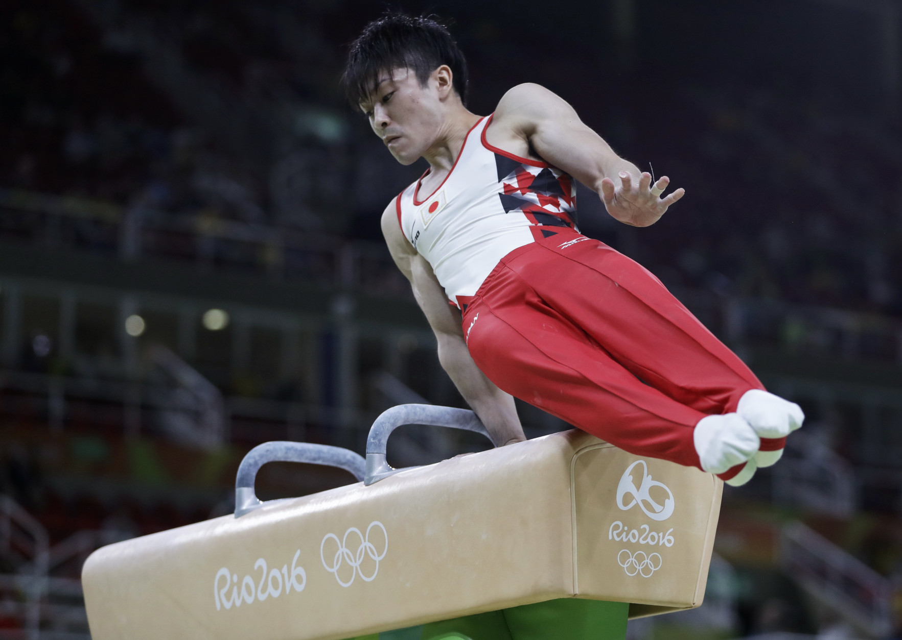 Japan's Kohei Uchimura performs on the pommel horse during the artistic gymnastics men's qualification at the 2016 Summer Olympics in Rio de Janeiro, Brazil, Saturday, Aug. 6, 2016. (AP Photo/Julio Cortez)