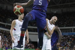 United States' Kevin Durant (5) reacts after dunking against Serbia during the men's gold medal basketball game at the 2016 Summer Olympics in Rio de Janeiro, Brazil, Sunday, Aug. 21, 2016. (AP Photo/Eric Gay)