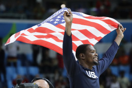 United States' Kevin Durant celebrates winning the men's basketball gold medal at the 2016 Summer Olympics in Rio de Janeiro, Brazil, Sunday, Aug. 21, 2016. (AP Photo/Matt York)