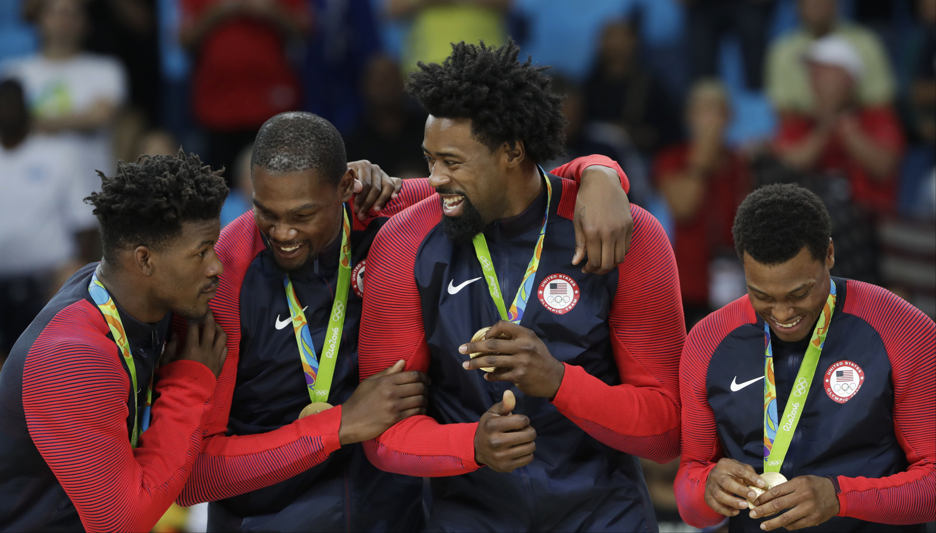 United States' Jimmy Butler, from left, Kevin Durant, DeAndre Jordan and Kyle Lowry stand on the podium with their gold medals for men's basketball at the 2016 Summer Olympics in Rio de Janeiro, Brazil, Sunday, Aug. 21, 2016. (AP Photo/Eric Gay)