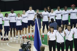 The French women's basketball team faces their country's flag during the national anthem before the first half of a game against Turkey at the Youth Center at the 2016 Summer Olympics in Rio de Janeiro, Brazil, Saturday, Aug. 6, 2016. (AP Photo/Carlos Osorio))