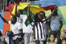 Senegal fans cheer during the second half of a women's basketball game against the United States at the Youth Center at the 2016 Summer Olympics in Rio de Janeiro, Brazil, Sunday, Aug. 7, 2016. The United States defeated Senegal 121-56. (AP Photo/Carlos Osorio)