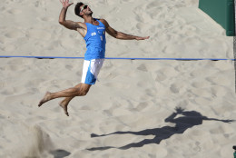Italy's Alex Ranghieri prepares to spike against Italy during a men's beach volleyball match at the 2016 Summer Olympics in Rio de Janeiro, Brazil, Saturday, Aug. 6, 2016. (AP Photo/Marcio Jose Sanchez)
