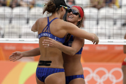 Unites States' Brooke Sweat, right, and Lauren Fendrick celebrate a point over Poland during a women's beach volleyball match at the 2016 Summer Olympics in Rio de Janeiro, Brazil, Sunday, Aug. 7, 2016. (AP Photo/Marcio Jose Sanchez)