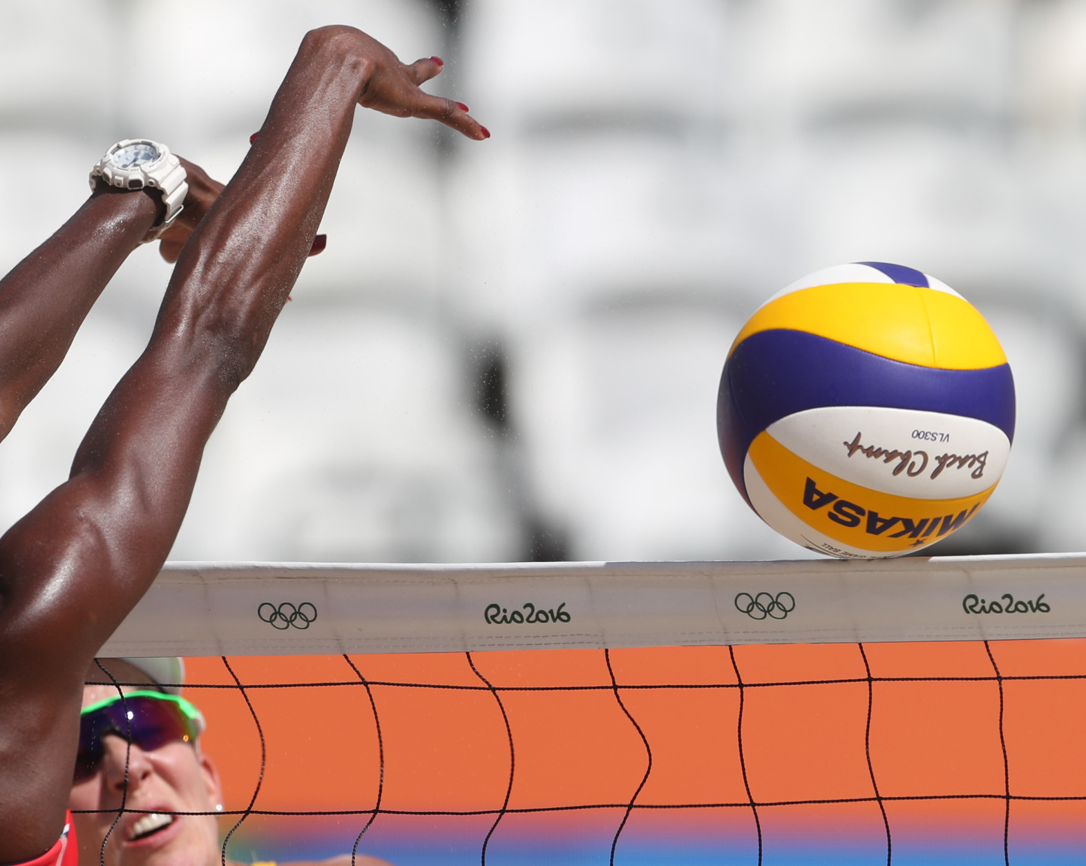 Costa Rica's Karen Cope Charless, left, tries to block Australia's Louise Bawden, right, during a women's beach volleyball match at the 2016 Summer Olympics in Rio de Janeiro, Brazil, Saturday, Aug. 6, 2016. (AP Photo/Petr David Josek)