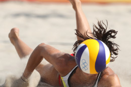 Spain's Elsa Baquerizo dives for a ball during a women's beach volleyball match against Argentina at the 2016 Summer Olympics in Rio de Janeiro, Brazil, Saturday, Aug. 6, 2016. (AP Photo/Petr David Josek)