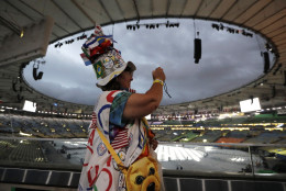 Vivianne Robinson takes photos before the start of the closing ceremony for the Summer Olympics in Rio de Janeiro, Brazil, Sunday, Aug. 21, 2016. (AP Photo/Mark Humphrey)