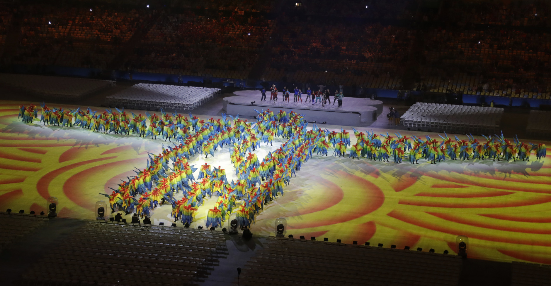 Performers stand in formation of the Christ the Redeemer during the closing ceremony in the Maracana stadium at the 2016 Summer Olympics in Rio de Janeiro, Brazil, Sunday, Aug. 21, 2016. (AP Photo/Chris Carlson)