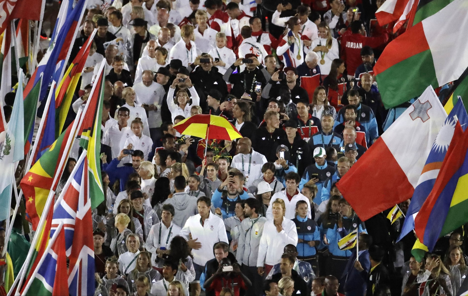 Athletes enter the closing ceremony in the Maracana stadium at the 2016 Summer Olympics in Rio de Janeiro, Brazil, Sunday, Aug. 21, 2016. (AP Photo/Charlie Riedel)