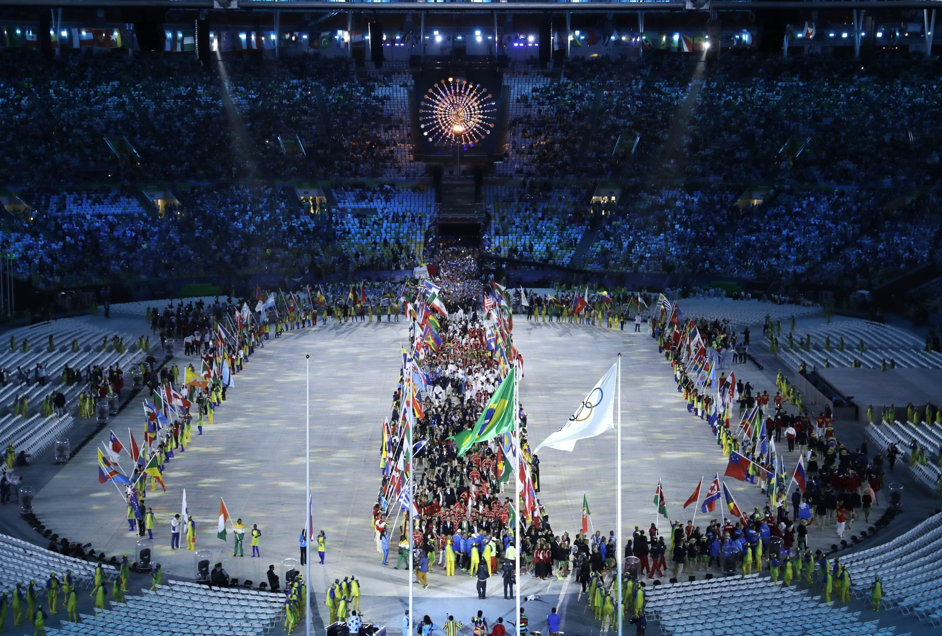 A parade of athletes enters the closing ceremony in the Maracana stadium at the 2016 Summer Olympics in Rio de Janeiro, Brazil, Sunday, Aug. 21, 2016. (AP Photo/Charlie Riedel)
