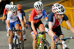 Mara Abbott, of the United States, leads Annemiek van Vleuten, of the Netherlands, during the women's cycling road race at the 2016 Summer Olympics in Rio de Janeiro, Brazil, Sunday, Aug. 7, 2016. (Bryn Lennon/Pool Photo via AP)