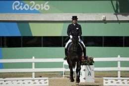 Ryuzo Kitajima, of Japan, rides Just Chocolate in the equestrian eventing dressage competition at the 2016 Summer Olympics in Rio de Janeiro, Brazil, Saturday, Aug. 6, 2016. (AP Photo/John Locher)