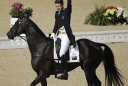 Christopher Burton, of Australia, reacts while riding Santano II after competing in the equestrian eventing dressage competition at the 2016 Summer Olympics in Rio de Janeiro, Brazil, Saturday, Aug. 6, 2016. (AP Photo/John Locher)
