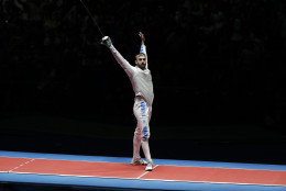 Daniele Garozzo of Italy celebrates after defeating Alexander Massialas of the United States and winning the gold medal at the men's individual foil fencing event at the 2016 Summer Olympics in Rio de Janeiro, Brazil, Sunday, Aug. 7, 2016. (AP Photo/Andrew Medichini)