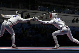 Auriane Malle of France, right, and Nguyen Thi Nhu Hoa of Vietnam compete in the women's individual epee event the 2016 Summer Olympics in Rio de Janeiro, Brazil, Saturday, Aug. 6, 2016. (AP Photo/Andrew Medichini)