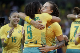 Brazil's Ana Paula Belo, right, celebrates with team mate Brazil's Ana Paula Belo after defeating Norway during the women's preliminary handball match between Norway and Brazil at the 2016 Summer Olympics in Rio de Janeiro, Brazil, Saturday, Aug. 6, 2016. (AP Photo/Matthias Schrader)