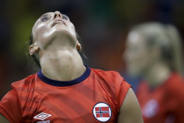 Norway's Camilla Herrem throws her head back as Norway lose the women's preliminary handball match between Norway and Brazil at the 2016 Summer Olympics in Rio de Janeiro, Brazil, Saturday, Aug. 6, 2016. (AP Photo/Ben Curtis)