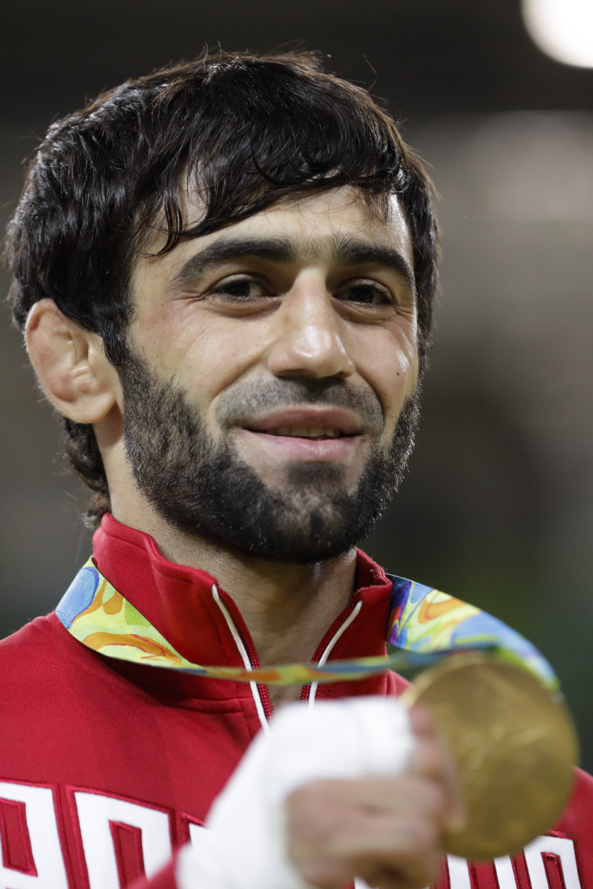 Russia's Beslan Mudranov celebrates with the gold medal after he wins the men's 60-kg judo competition at the 2016 Summer Olympics in Rio de Janeiro, Brazil, Saturday, Aug. 6, 2016. (AP Photo/Markus Schreiber)