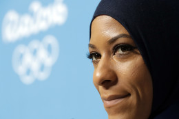 FILE - In this Aug. 4, 2016, file photo, United States fencer Ibtihaj Muhammad talks with journalists during a news conference she held ahead of the 2016 Summer Olympics in Rio de Janeiro, Brazil. Muhammad has used her profile as an Olympian to try and change misconceptions others might have about Muslim Americans. On Monday, Aug. 8 she'll become the first U.S. athlete to wear a hijab during the Olympics. (AP Photo/Andrew Medichini, File)