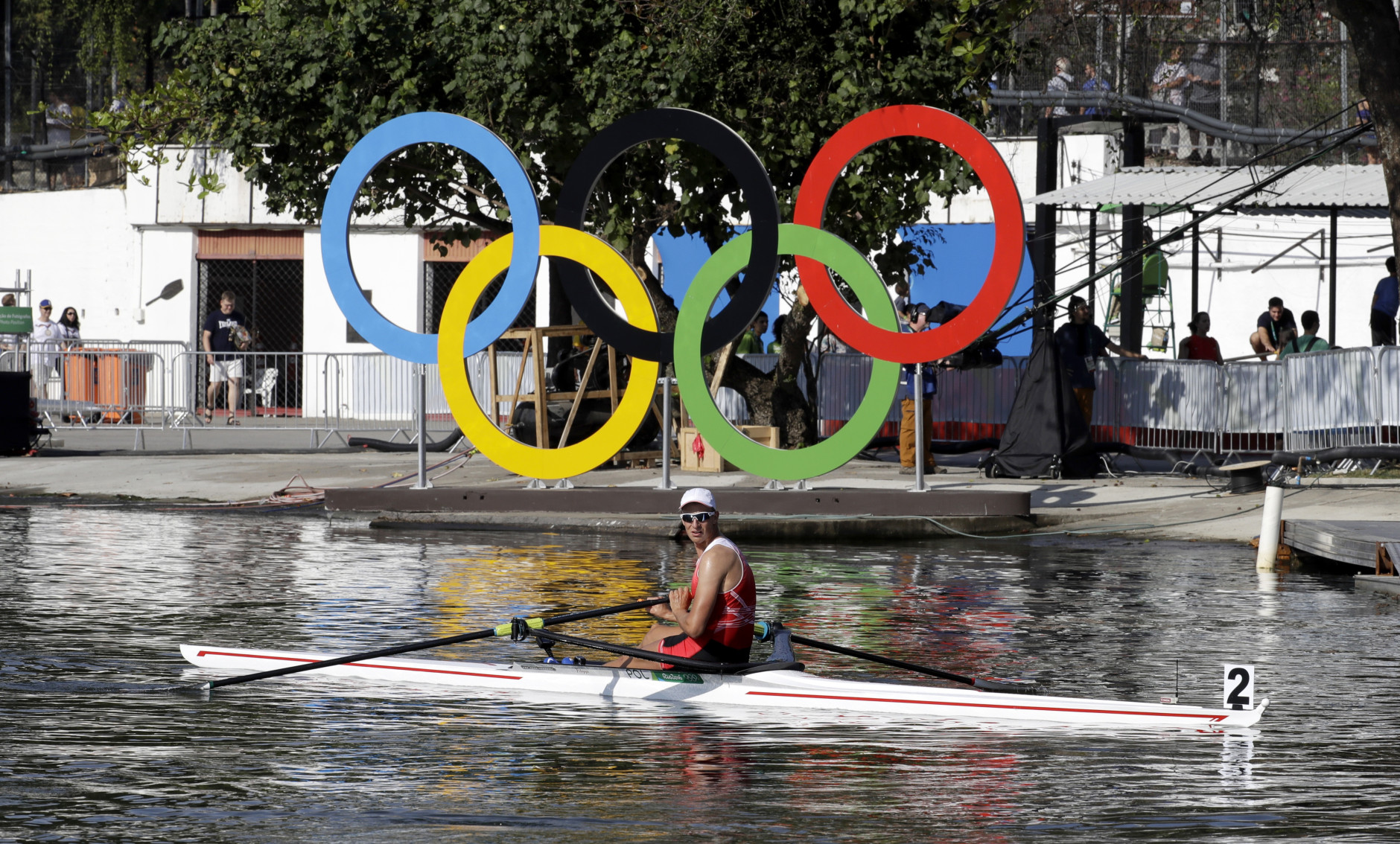 Natan Wegrzycki-Szymczyk, of Poland, looks at the results after competing in the men's single scull heat during the 2016 Summer Olympics in Rio de Janeiro, Brazil, Saturday, Aug. 6, 2016. (AP Photo/Andre Penner)