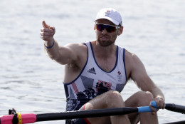 Alan Campbell, of Britain, points to the crowd after competing in the men's single scull heat during the 2016 Summer Olympics in Rio de Janeiro, Brazil, Saturday, Aug. 6, 2016. (AP Photo/Andre Penner)