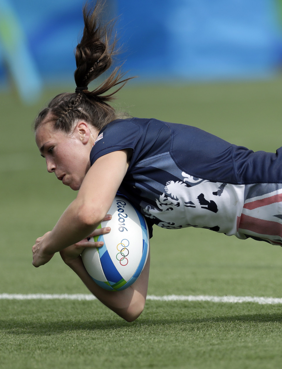 Great Britain's Emily Scarratt, scores a try during the women's rugby sevens match against Canada at the Summer Olympics in Rio de Janeiro, Brazil, Sunday, Aug. 7, 2016. (AP Photo/Themba Hadebe)