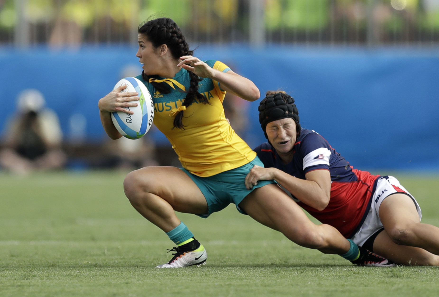 Australia's Charlotte Caslick, left, is tackled by USA's Lauren Doyle, during the women's rugby sevens match at the Summer Olympics in Rio de Janeiro, Brazil, Sunday, Aug. 7, 2016. (AP Photo/Themba Hadebe)