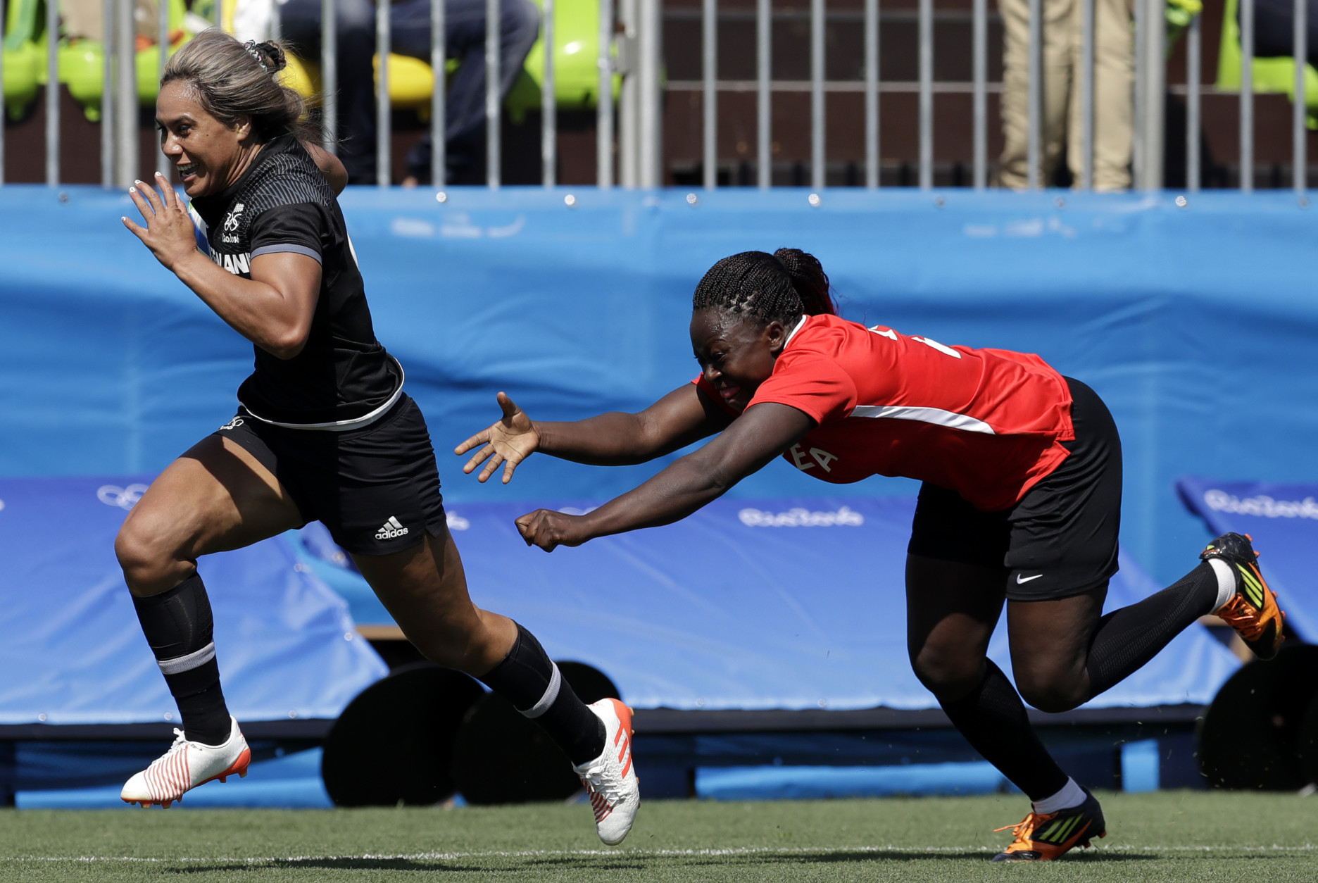 New Zealand's Huriana Manuel, left, breaks away from Kenya's Janet Owino, to score a try during the women's rugby sevens match between New Zealand and Kenya at the Summer Olympics in Rio de Janeiro, Brazil, Saturday, Aug. 6, 2016. (AP Photo/Themba Hadebe)