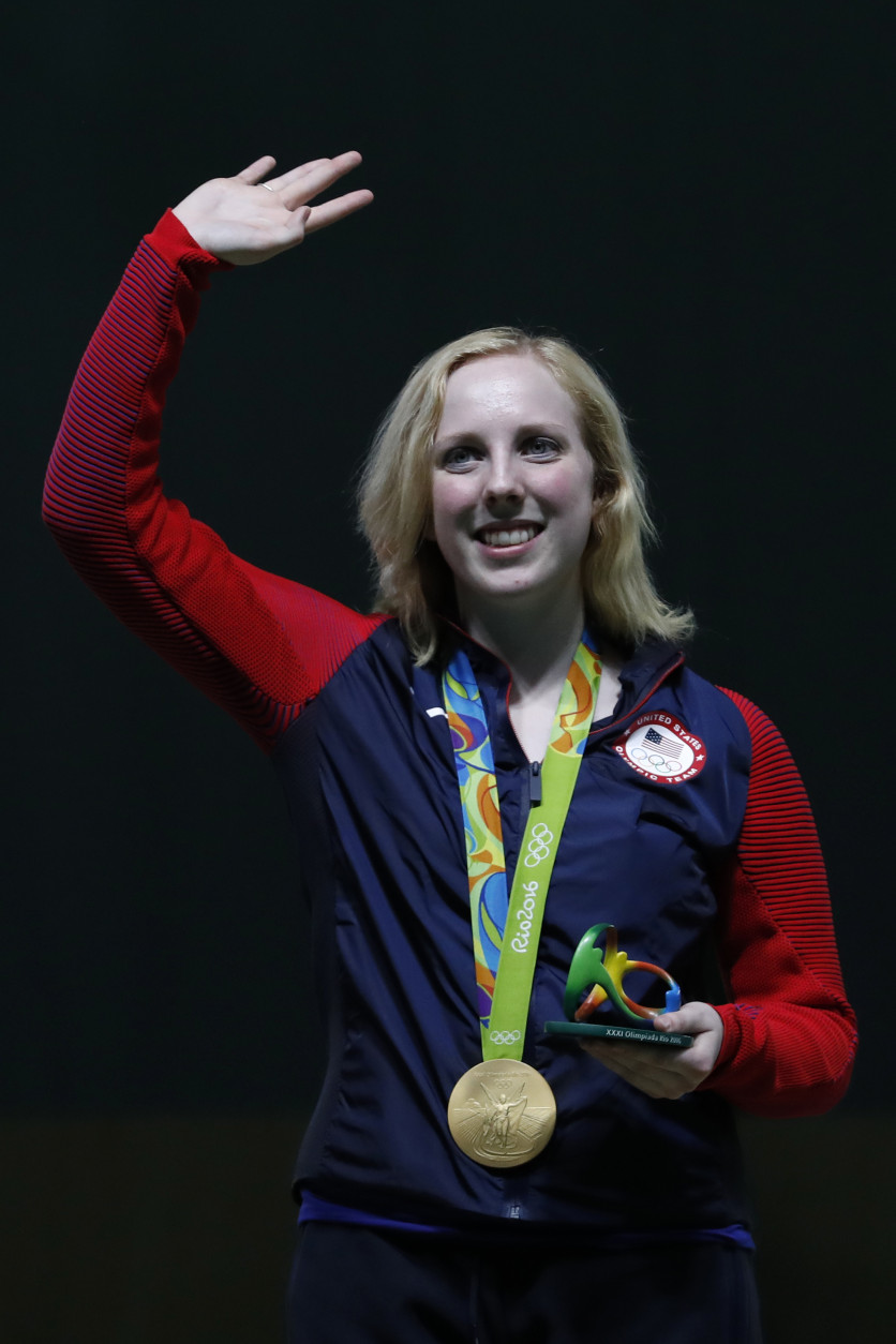 Virginia Thrasher of the United States celebrates won the gold medal during the victory ceremony for the Women's 10m Air Rifle event, at Olympic Shooting Center at the 2016 Summer Olympics in Rio de Janeiro, Brazil, Saturday, Aug. 6, 2016. (AP Photo/Hassan Ammar)