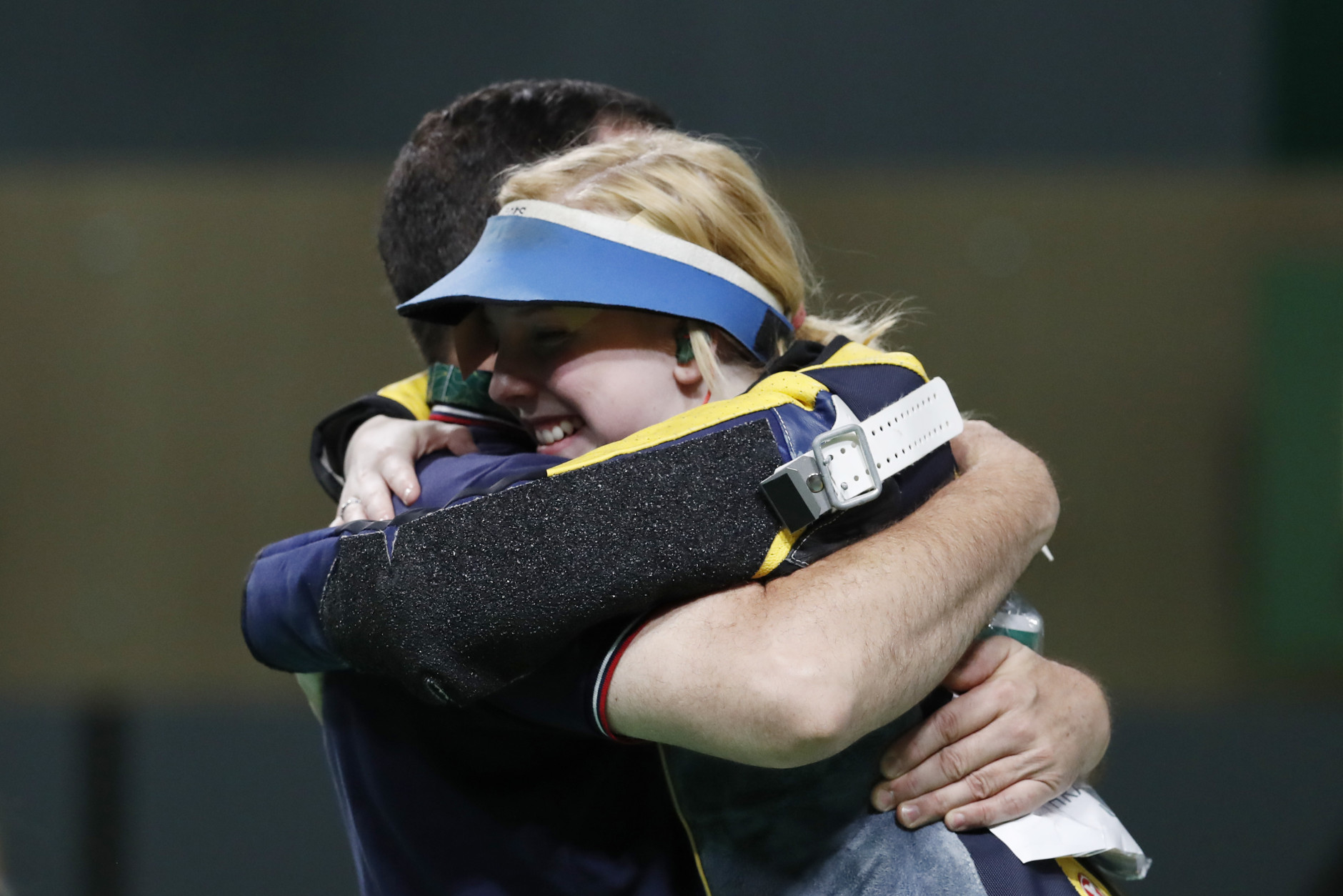 Virginia Thrasher of the United States celebrates with her coach winning the gold medal during the victory ceremony for the Women's 10m Air Rifle event, at Olympic Shooting Center at the 2016 Summer Olympics in Rio de Janeiro, Brazil, Saturday, Aug. 6, 2016. (AP Photo/Hassan Ammar)
