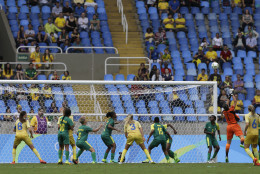 South Africa goalkeeper Roxanne Barker fails to grab the ball before Sweden's Nilla Fischer scored her team's first goal during the opening match of the Women's Olympic Football Tournament between Sweden and South Africa at the Rio Olympic Stadium in Rio de Janeiro, Brazil, Wednesday, Aug. 3, 2016. (AP Photo/Leo Correa)