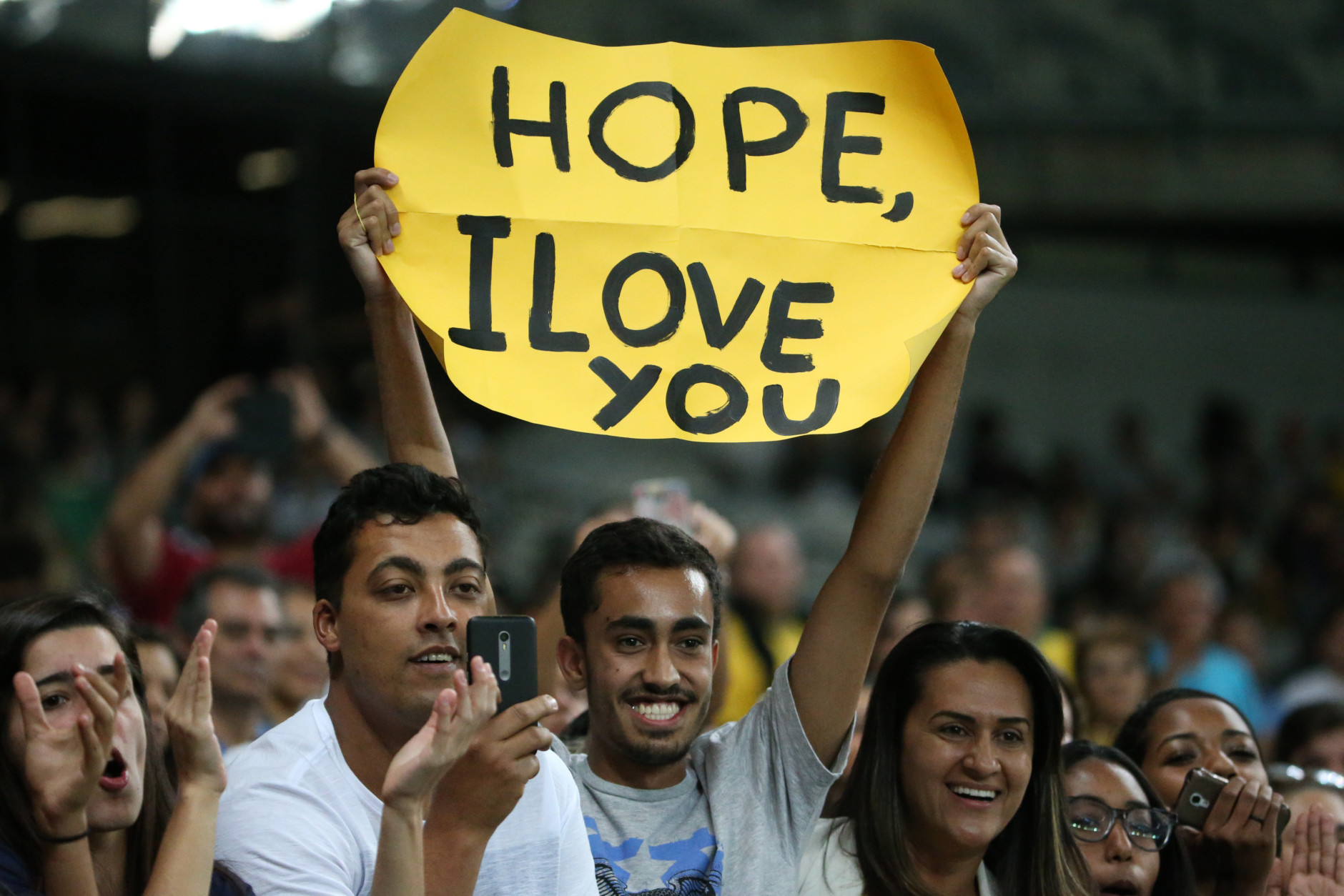 """A fan of United States' goalkeeper Hope Solo, holds a sign that reads """"Hope, I Love You"""" during a group G match of the women's Olympic football tournament between United States and France at the Mineirao stadium in Belo Horizonte, Brazil, Saturday, Aug. 6, 2016. United States won 1-0. (AP Photo/Eugenio Savio)"""